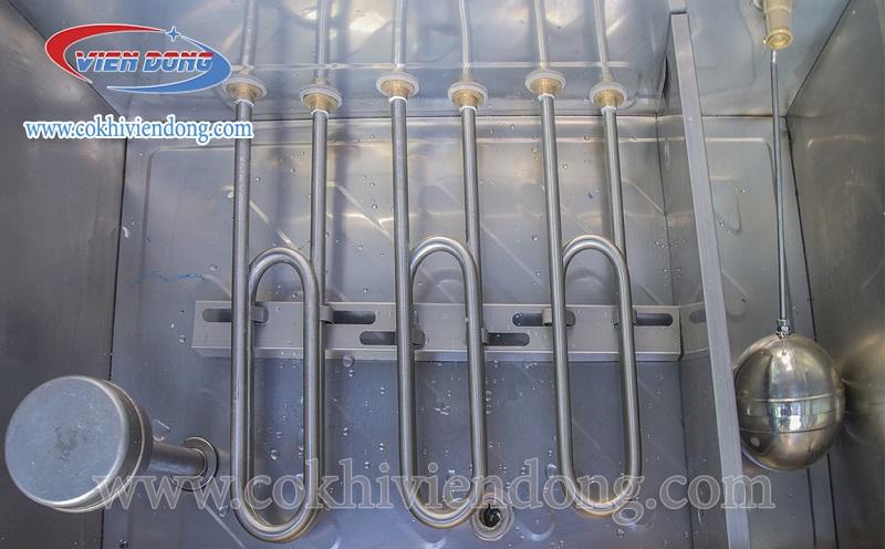 Hệ thống thanh nhiệt và phao nước ở tủ nấu cơm công nghiệp bằng điện